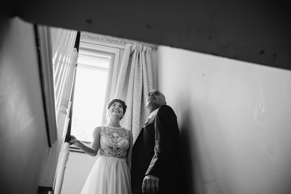 bride waiting with groom on stairs
