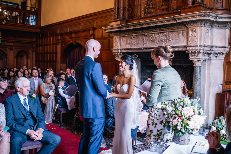 Bride and Groom exchanging vows at Rhinefield House