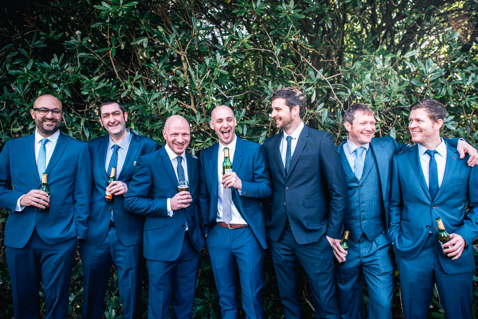 groom and friends laughing for photo
