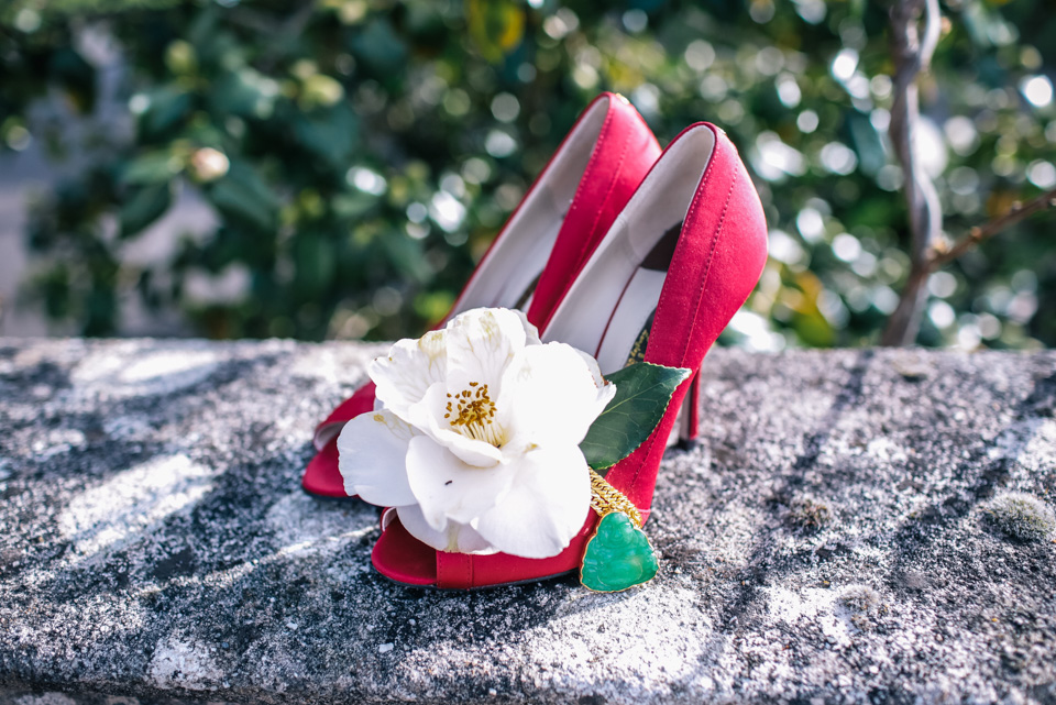 red shoes with white flower