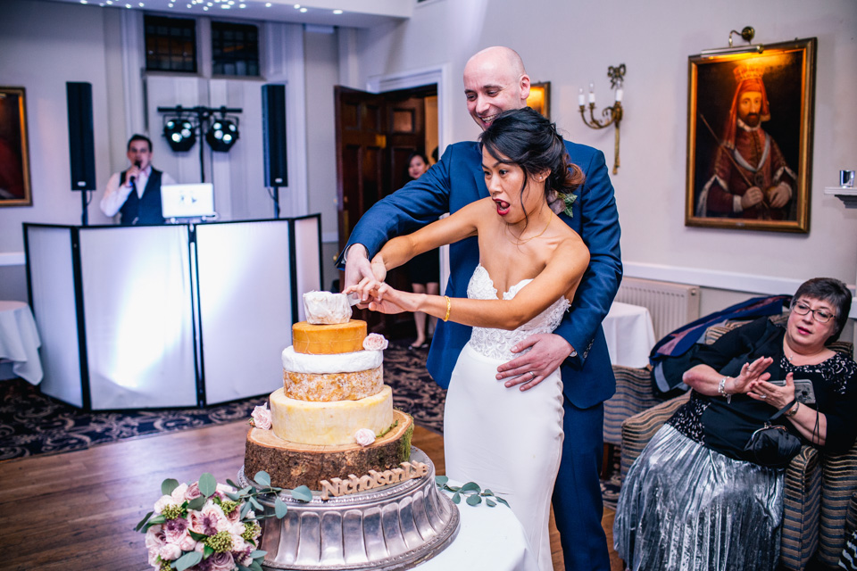 Bride and groom cutting the cheese cake on the dance floor