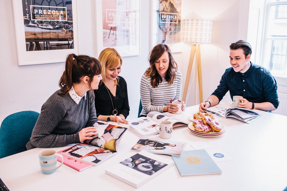 interior designers chatting at prezola