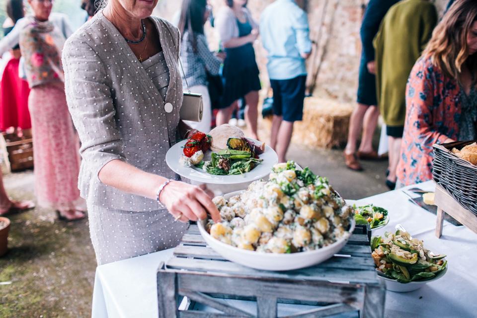 woman eating vegan food at wedding