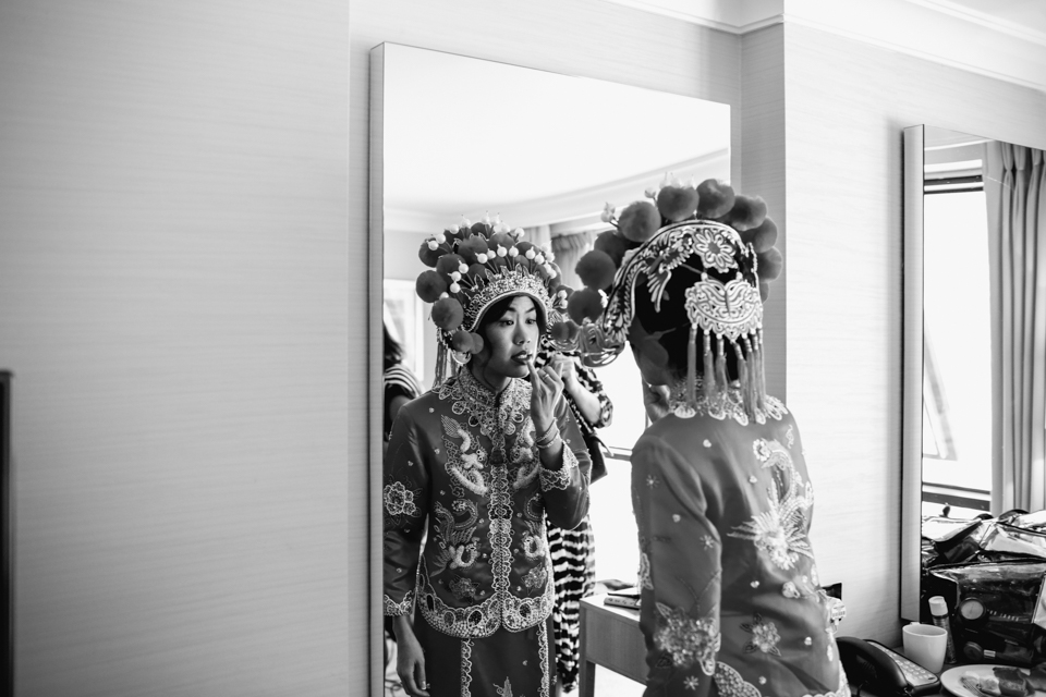 Chinese bride looking in mirror