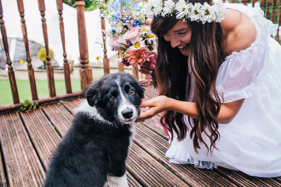 bride fussing puppy before ceremony