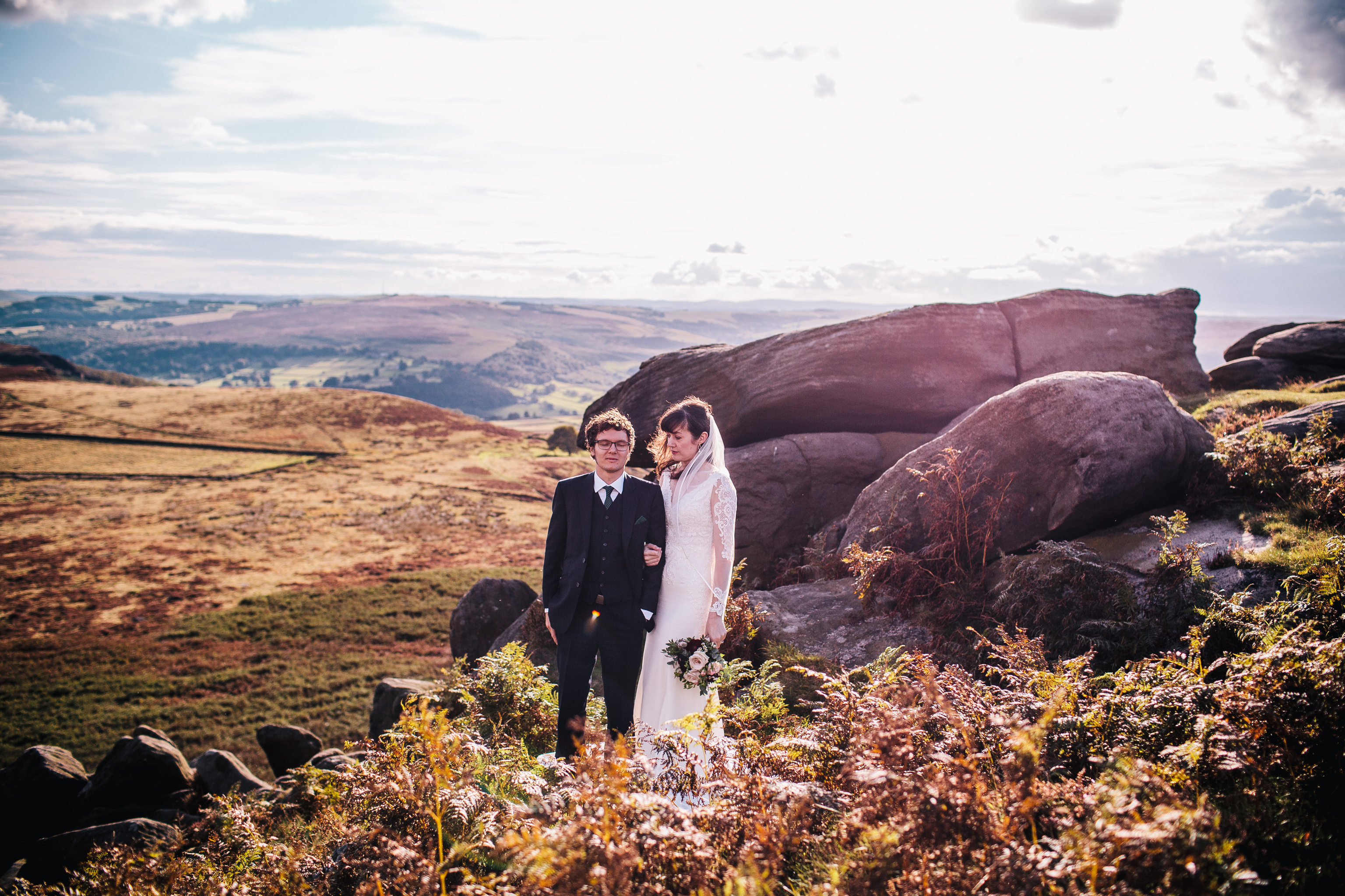 couple standing amongst the heathers at the Peak District