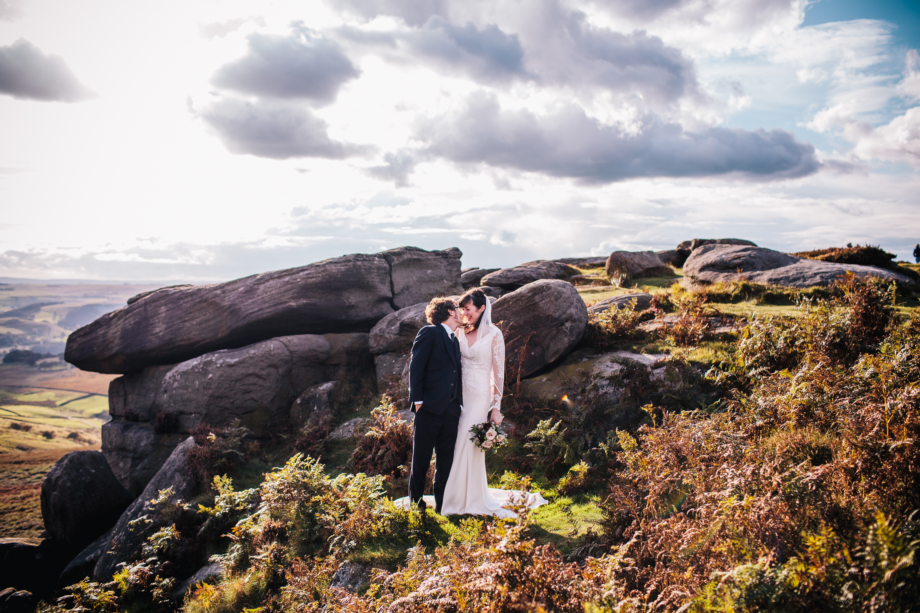 bride and groom amongst heathers in the Peak District