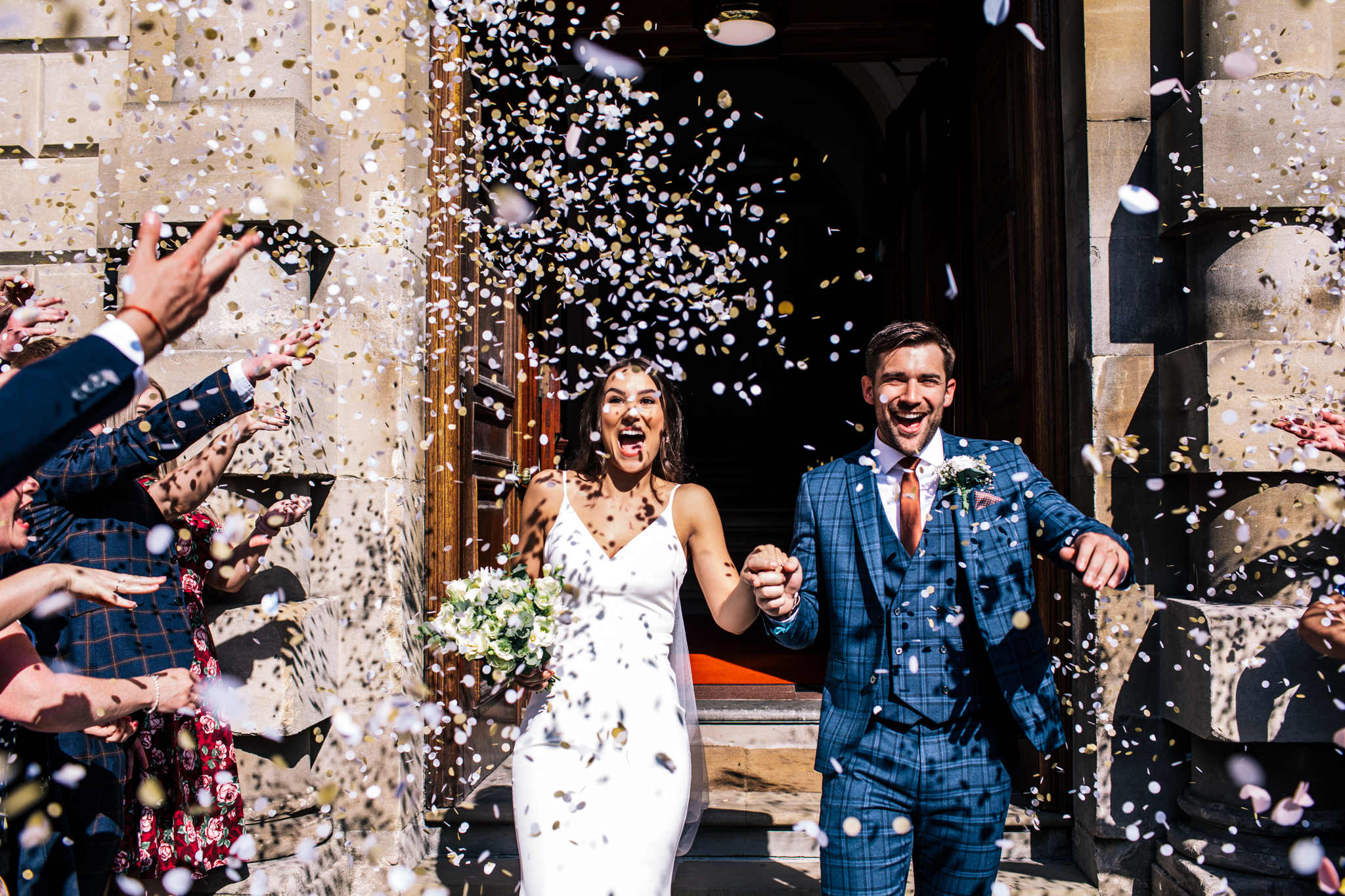 bath guildhall fun couple laughing as loads of confetti is thrown over
