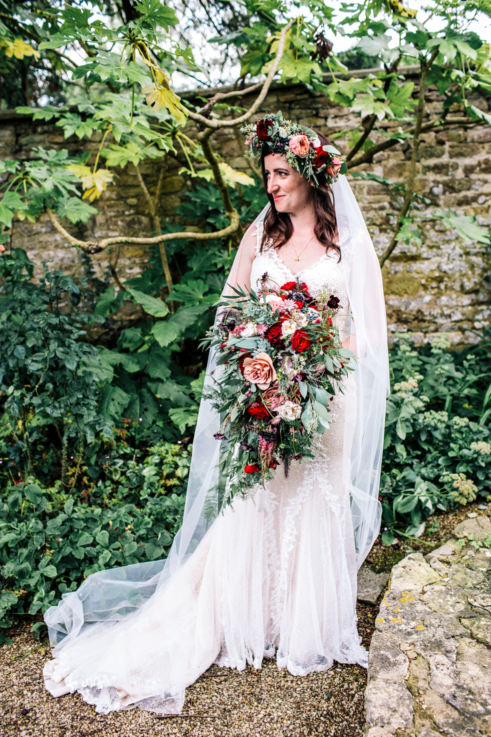 Bride looking stunning dressed like Midsomer Nights Dream at actor and literature themed wedding at Owlpen Manor