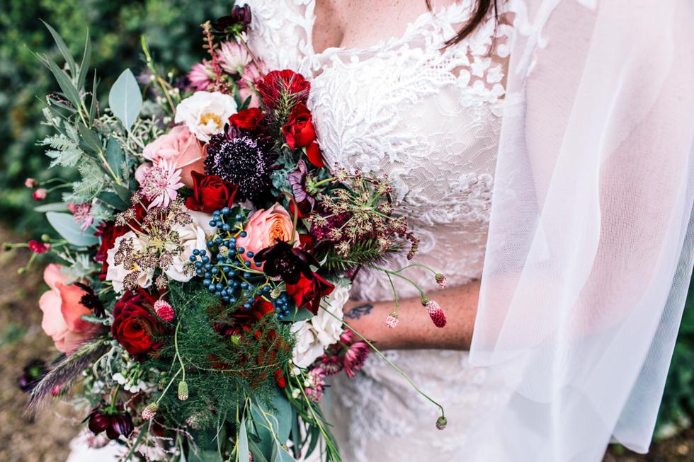 unusual dark and wild botanicals for wedding bouquet