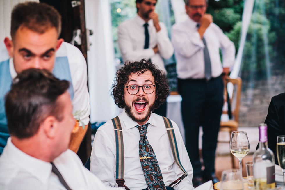 wedding guest in braces laughing at speeches