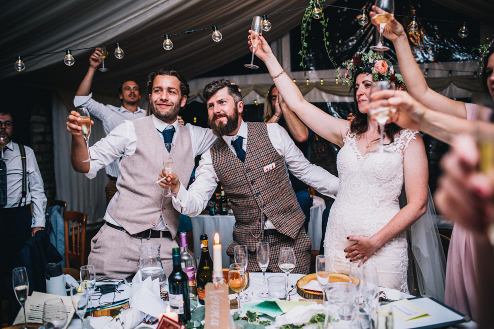celebrating with champagne at the end of the wedding speeches