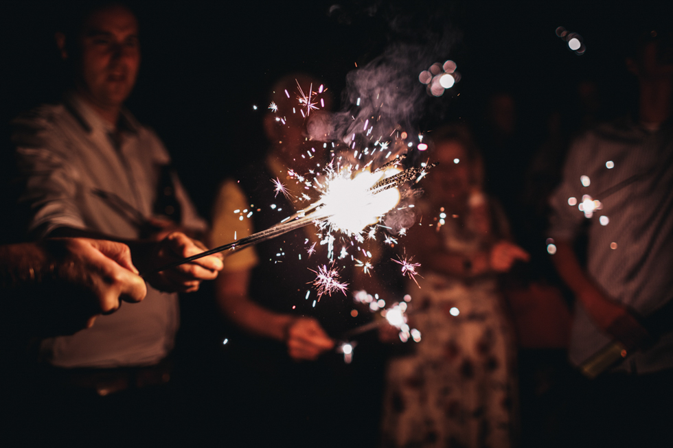 sparklers and fireworks at Owlpen Manor festival wedding