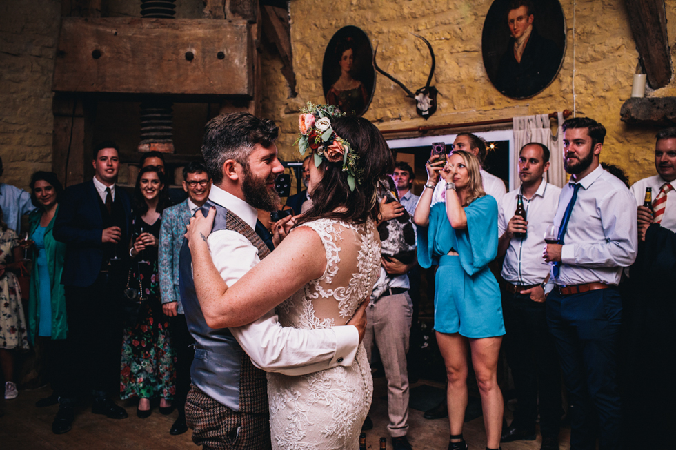 quirky and fun bride and groom dancing to tears for fears at their first dance