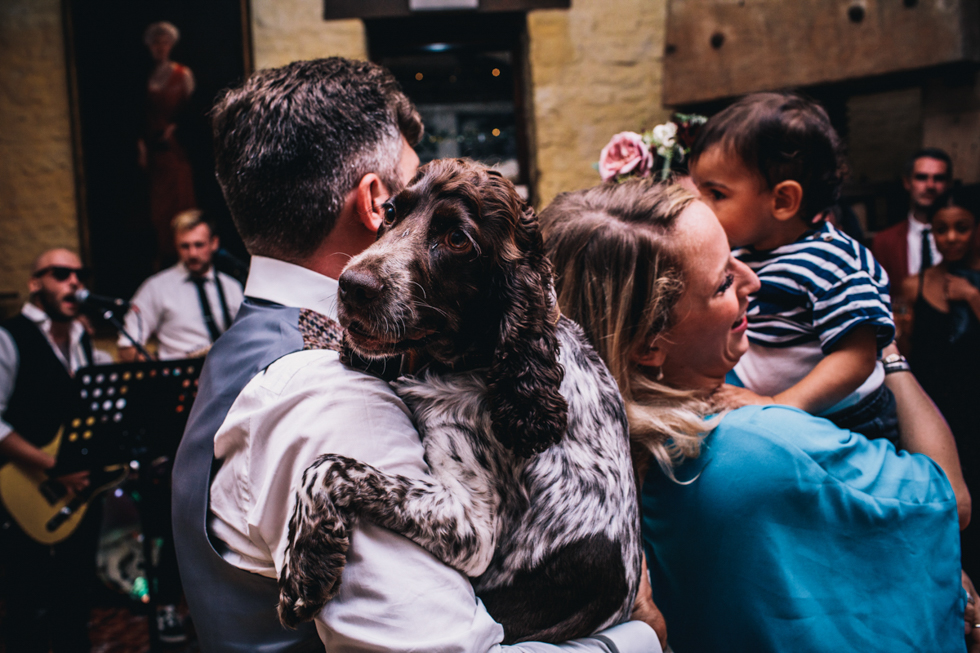 grooms dog getting a cuddle and a dance at Owlpen Manor
