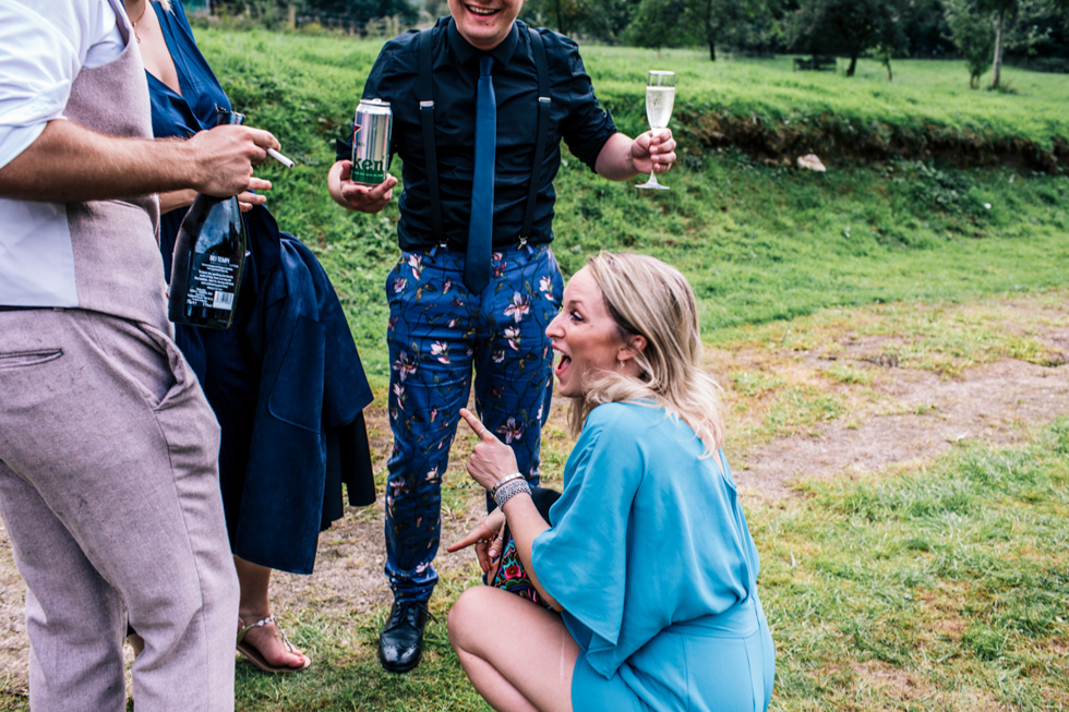 wedding guest caught on her knees with another friend in funny pose