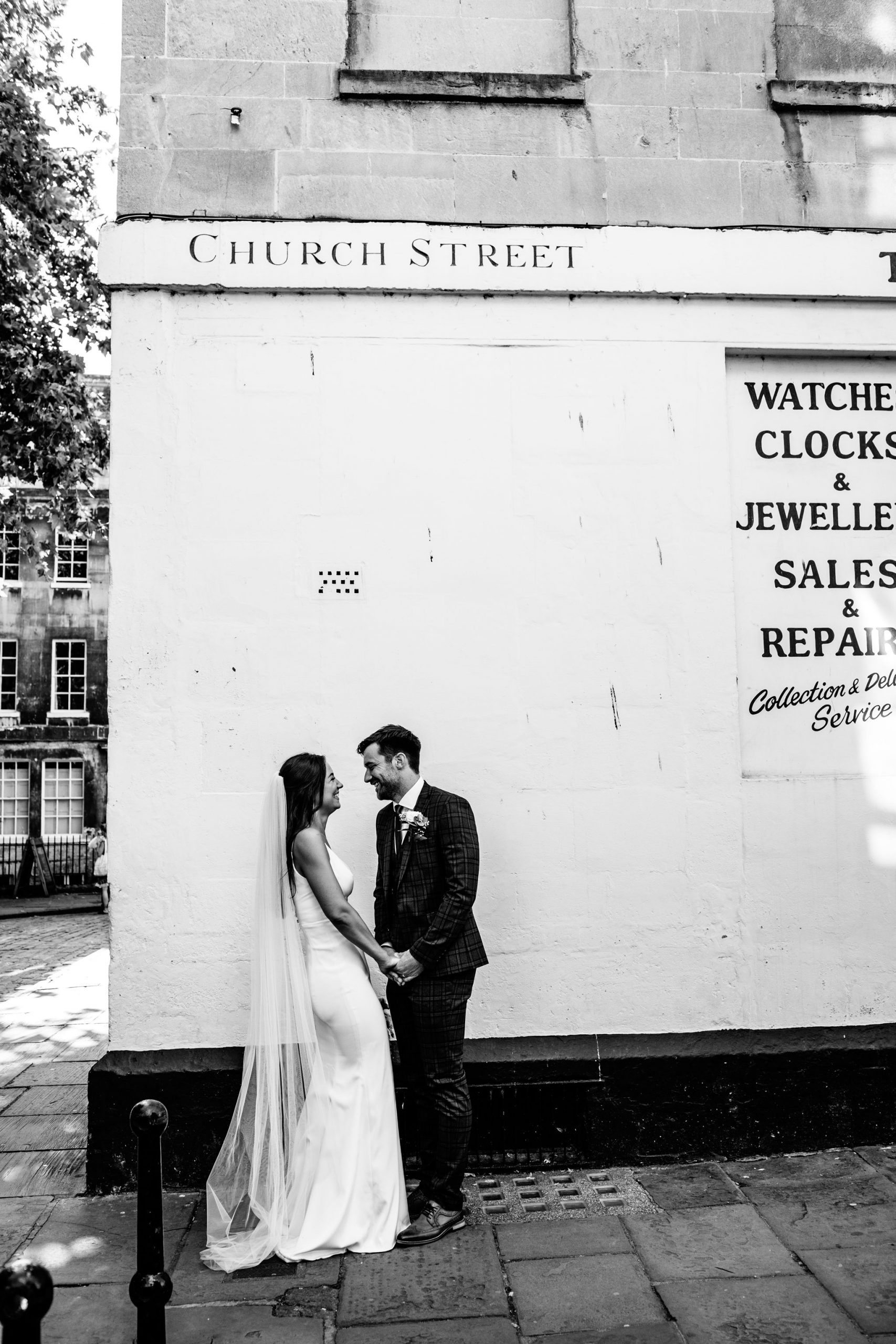 bride laughing with groom in bath city following their elopement