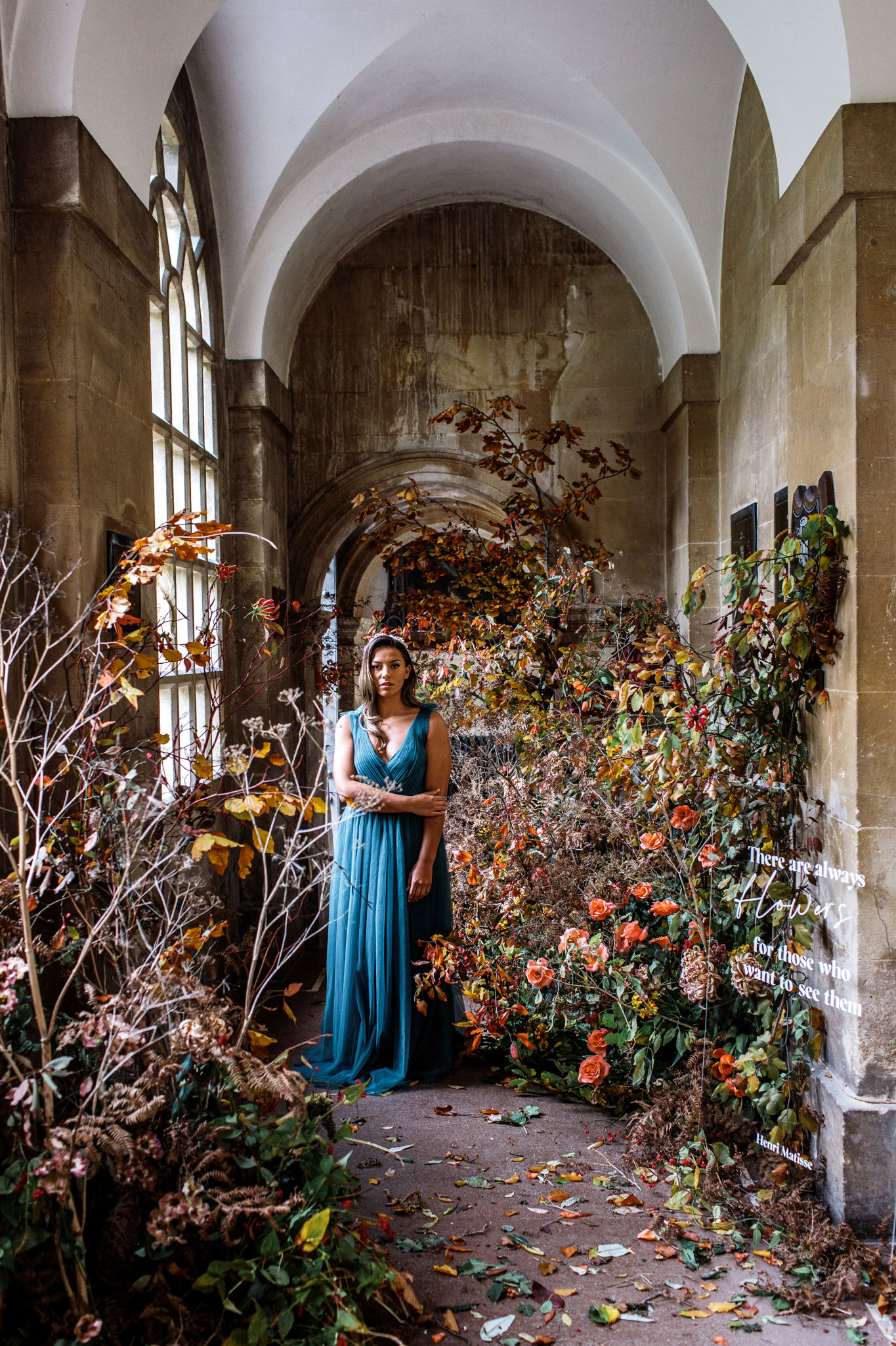 bride wearing a floaty green THTH bridesmaids dress surrounded my florals for a small different wedding in bath