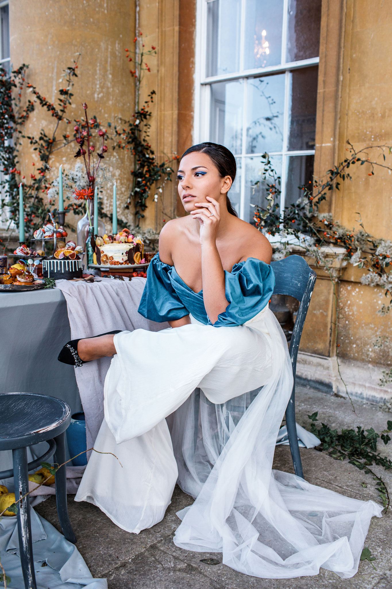 bride wearing blue velvet asos top for small wedding elopement and white trousers with a long veil in bath