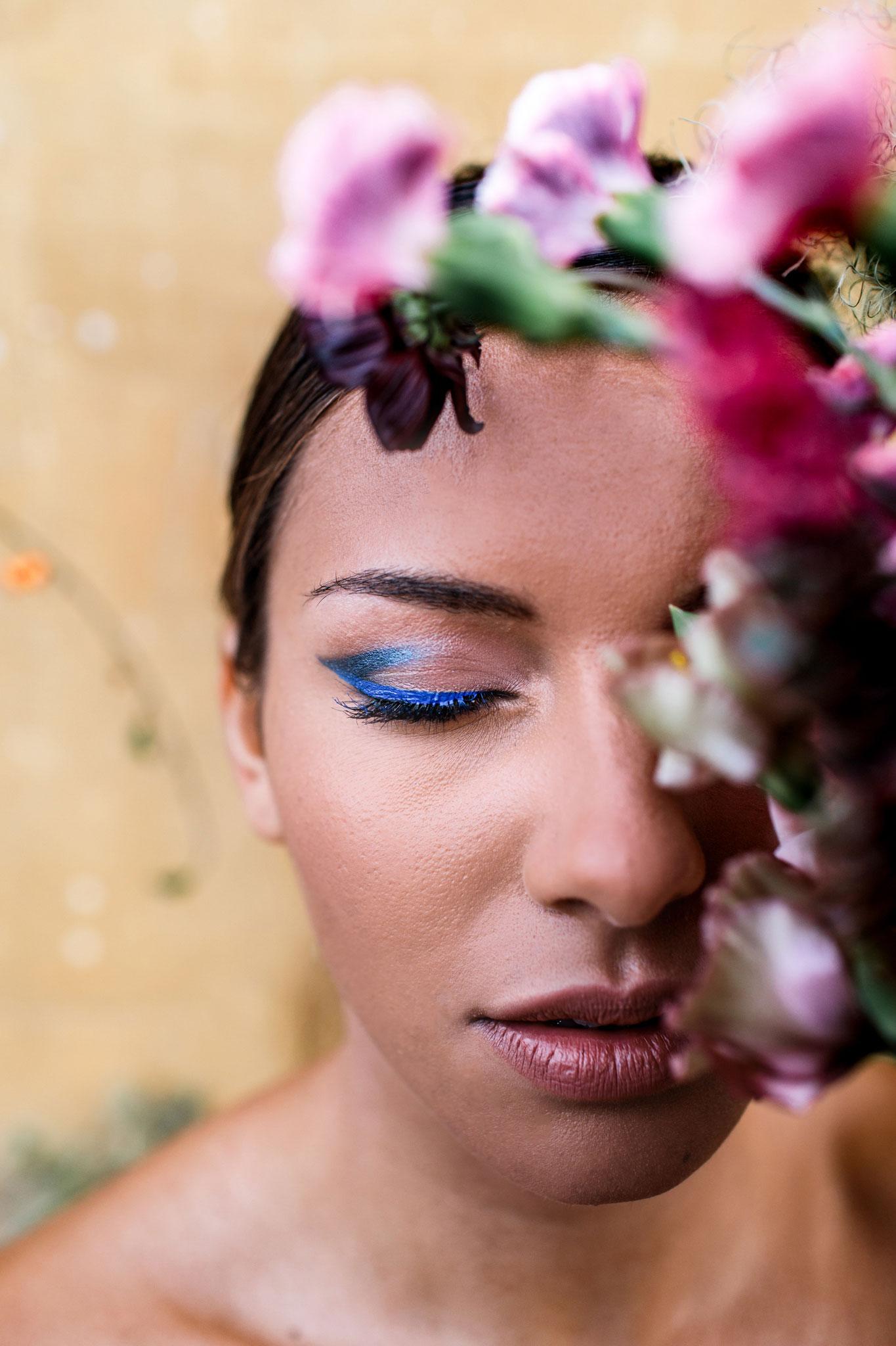 editorial fashion forward bride wearing electric blue eye makeup