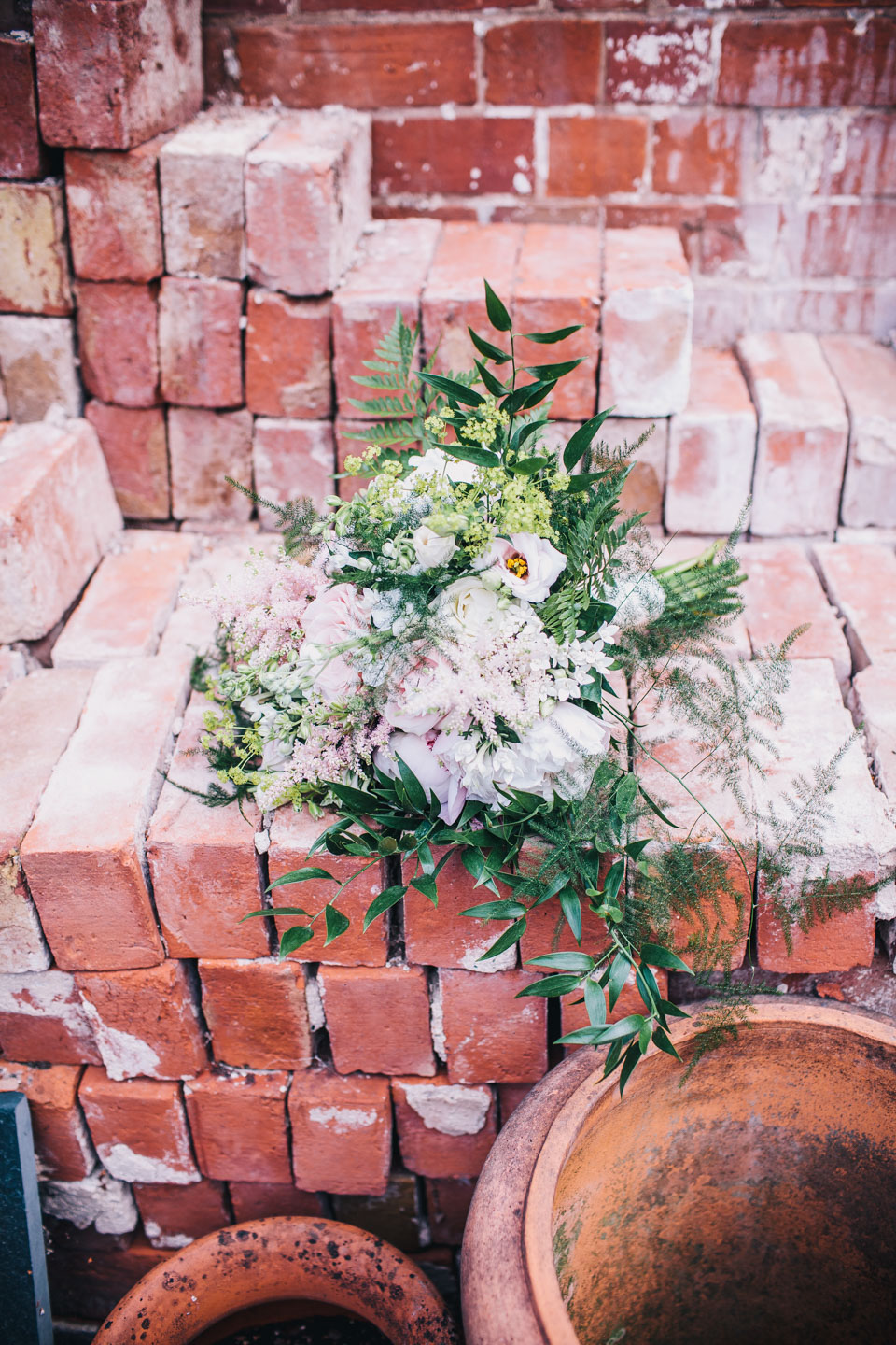 rustic flower on red brick