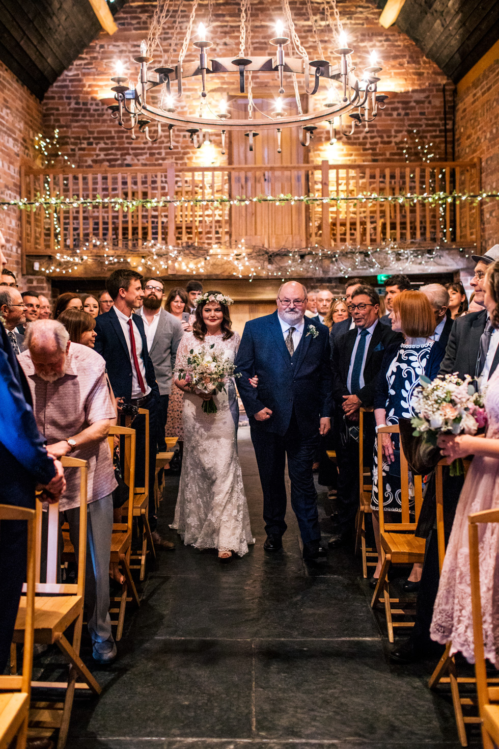 bride being walked down the aisle by her dad at the Curradine barns
