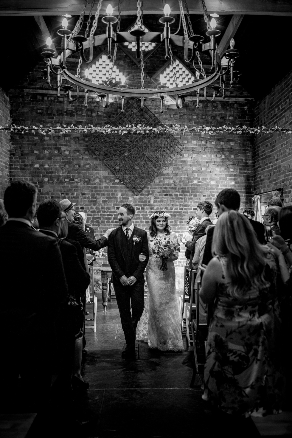 bride and groom walking out of the wedding room after just getting married