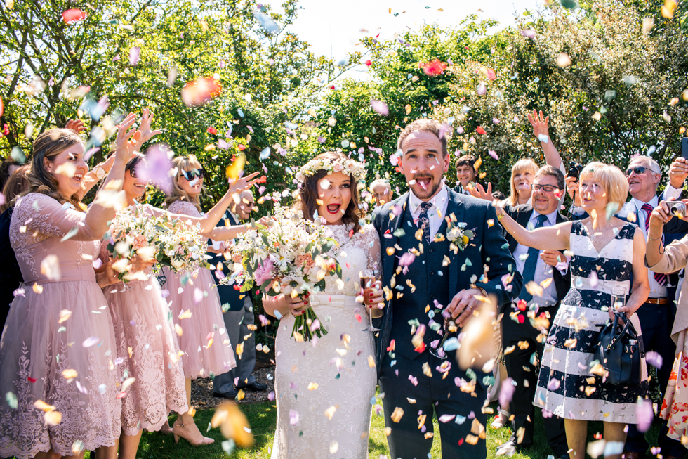 loads of confetti in the couples face at the Curradine Barns near Worcestershire
