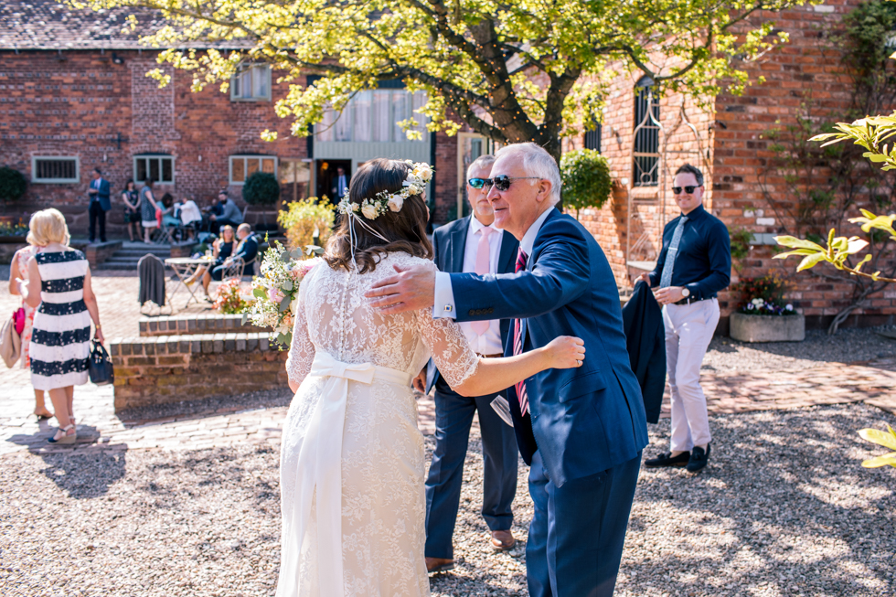 bride greeting guests at the Curradine Barns