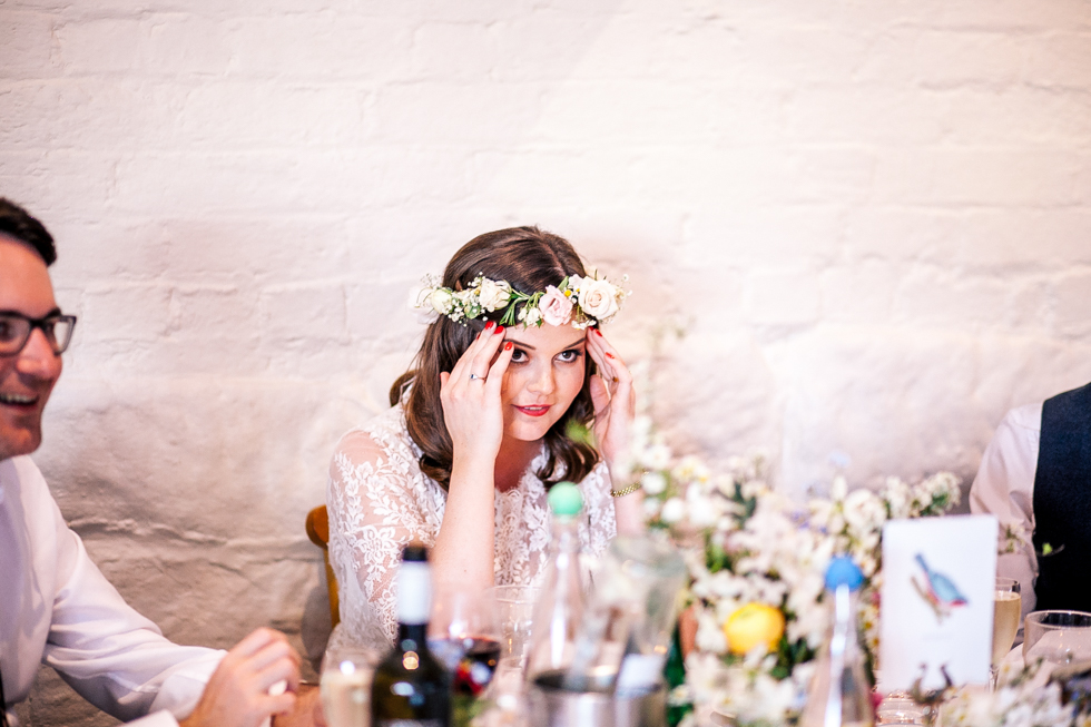 bride looking humiliated by wedding speech from her dad