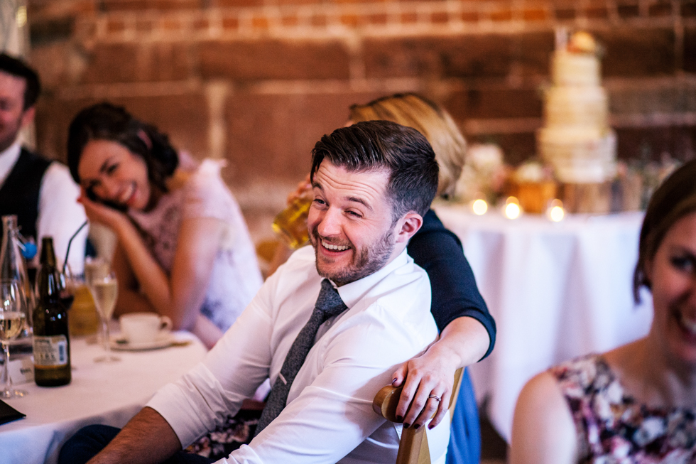 wedding guests joining in the speeches at the Curradine Barns