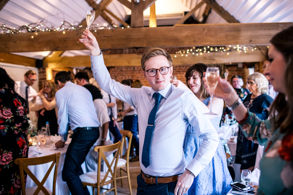 guests raising their glass to toast the couple at the Curradine barn