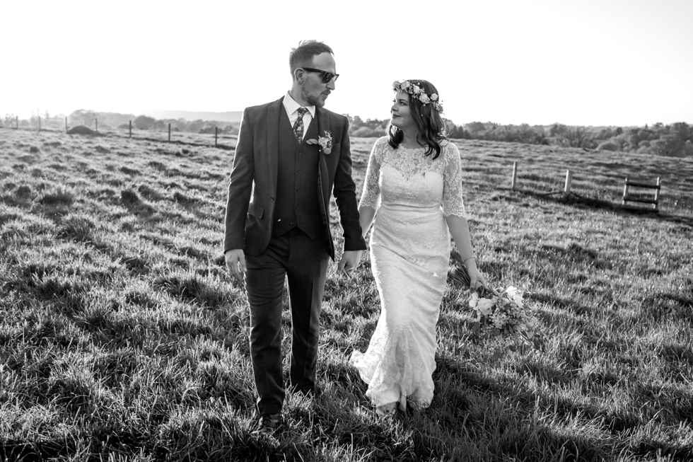 fun and alternative bride and groom walking in the sunshine at their wedding