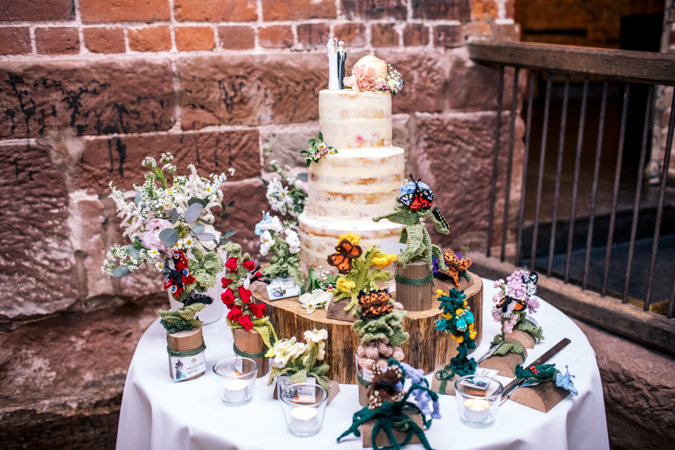 brides home made wedding cake with her mums crocheted woodland animals surrounding the base