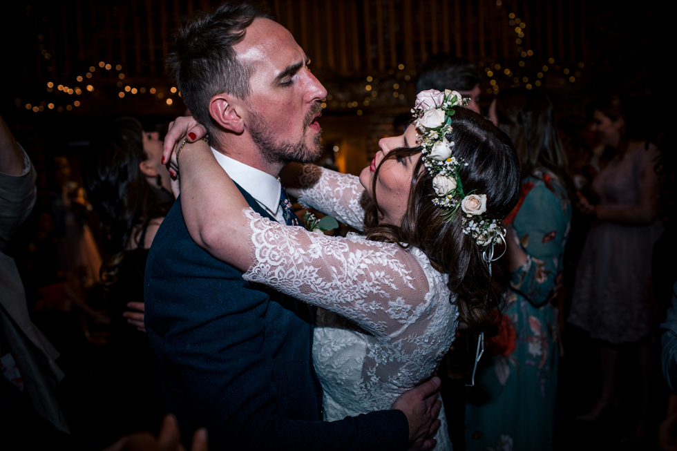bride and groom in full swing dancing to their DJ set list