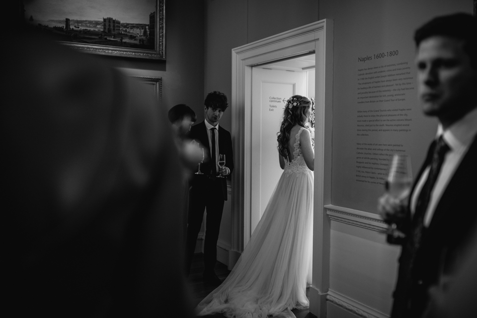 bride walking down the aisle at Compton Verny after just getting married with her dress floating behind