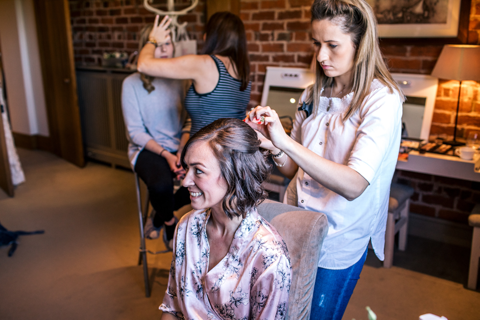 bridesmaids getting ready at the Curradine barns