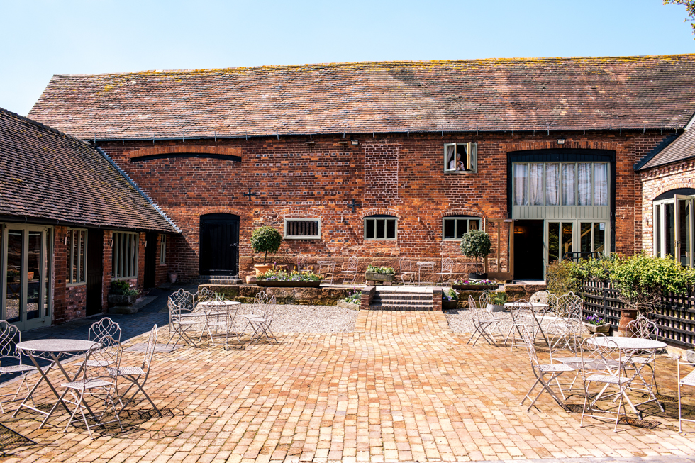 sunny day at the Curradine barns wedding venue near Worcestershire