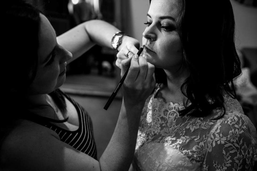 last touches to brides makeup being done at the Curradine barns