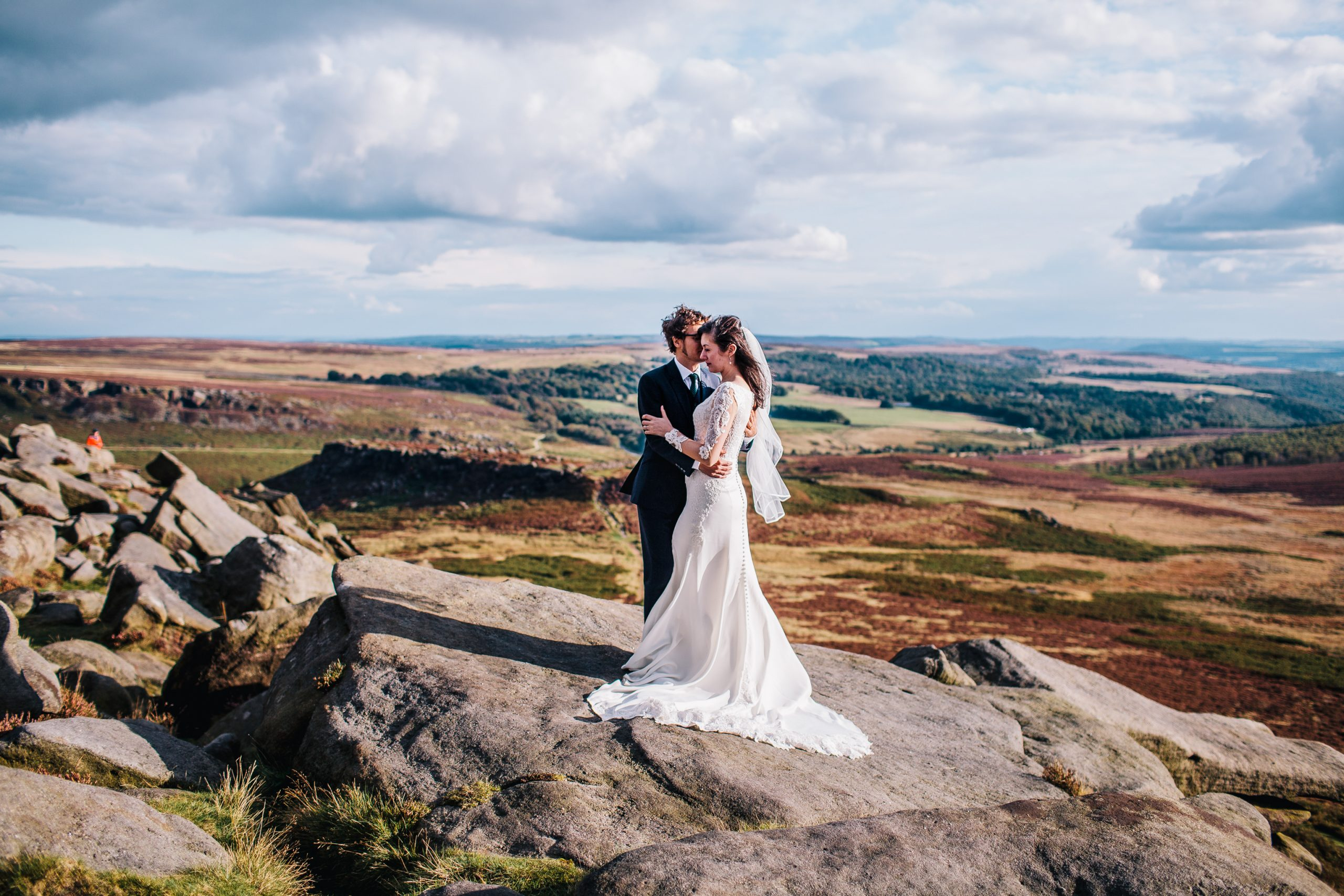 couple standing on rock Peak District with amazing background