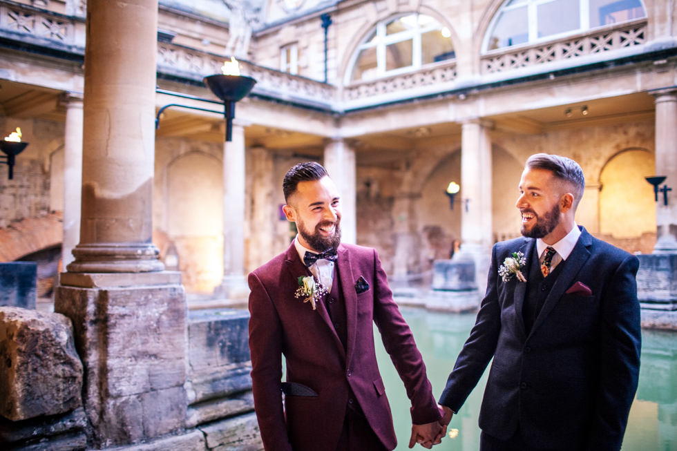 gay wedding at Roman baths stood right by the water at twilight