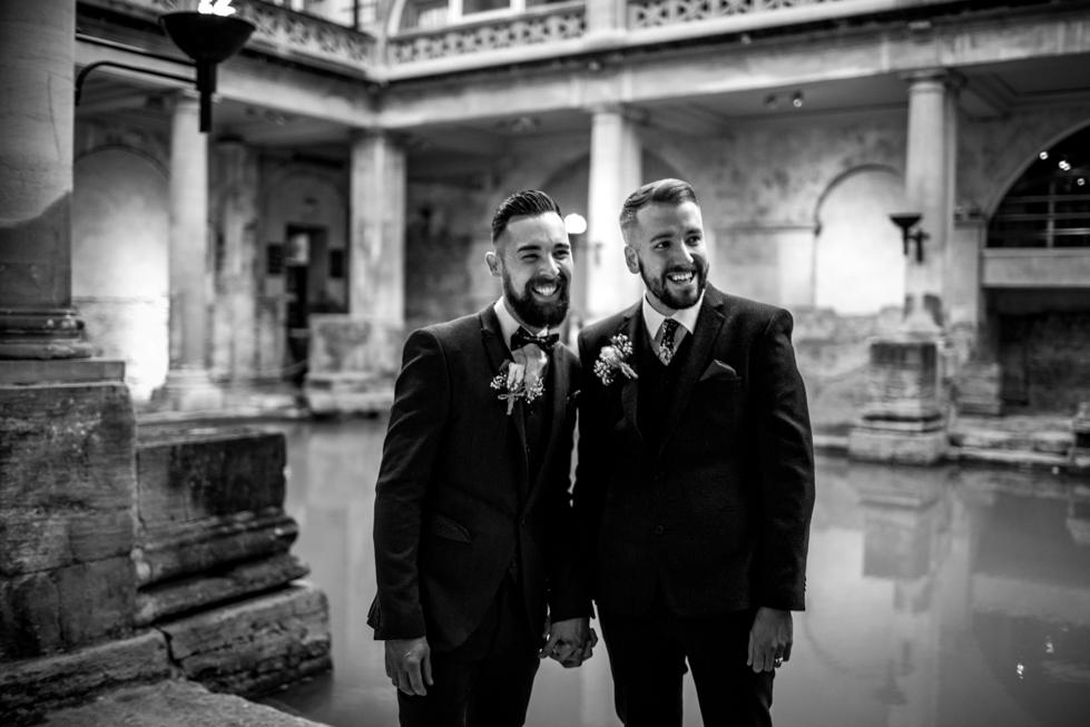 happy grooms married at roman baths