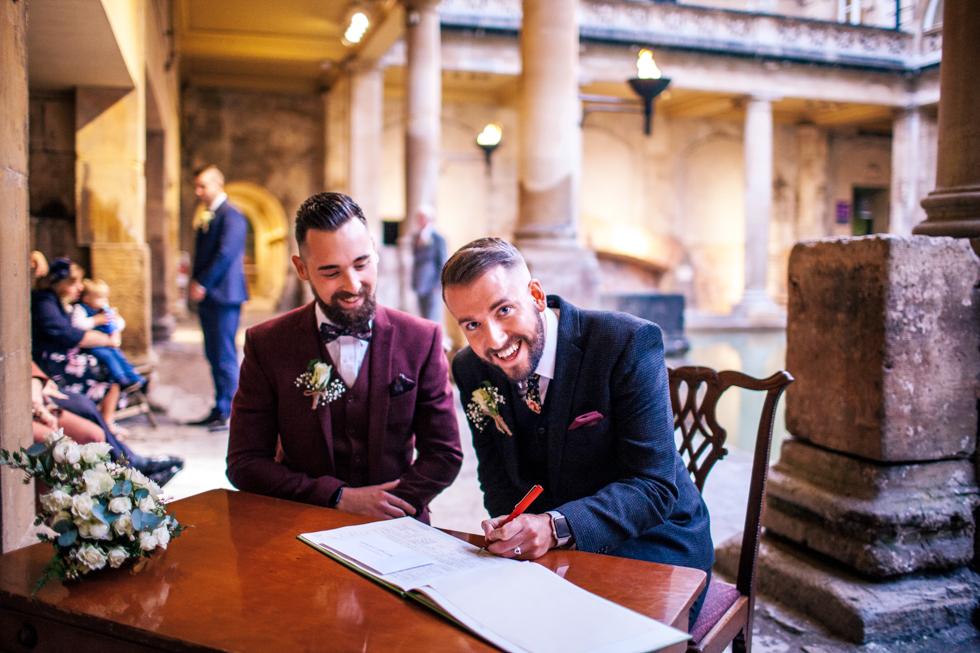 groom signing wedding vows at twilight wedding at bath