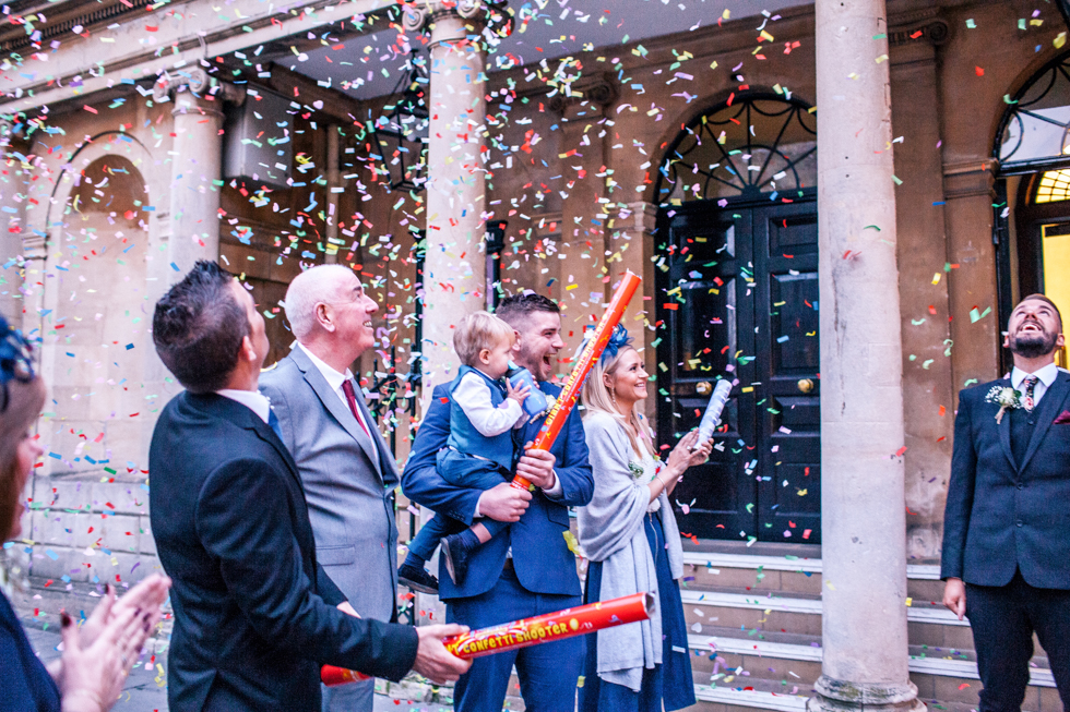 guests looking at confetti being taken by the wind outside the Roman baths