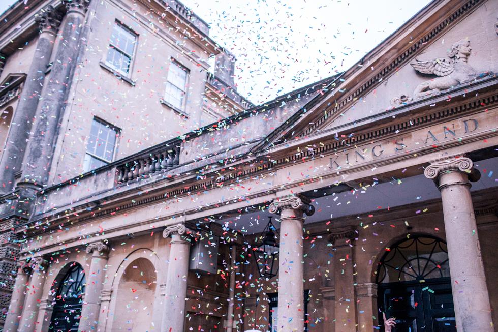 confetti blowing in the wind near the Roman baths