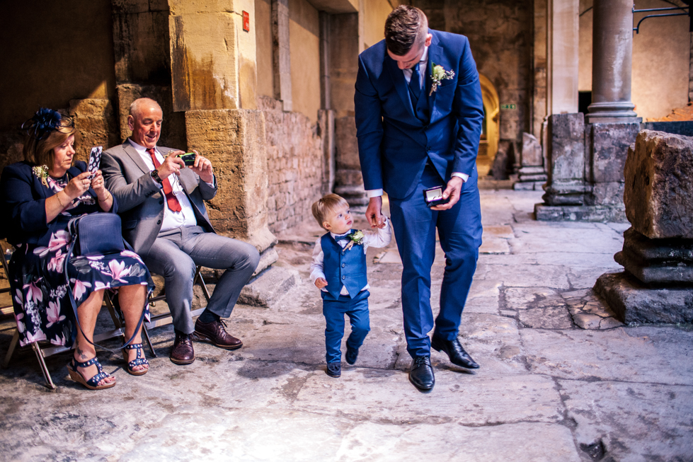 18 month old as ring bearer for couple at Roman baths