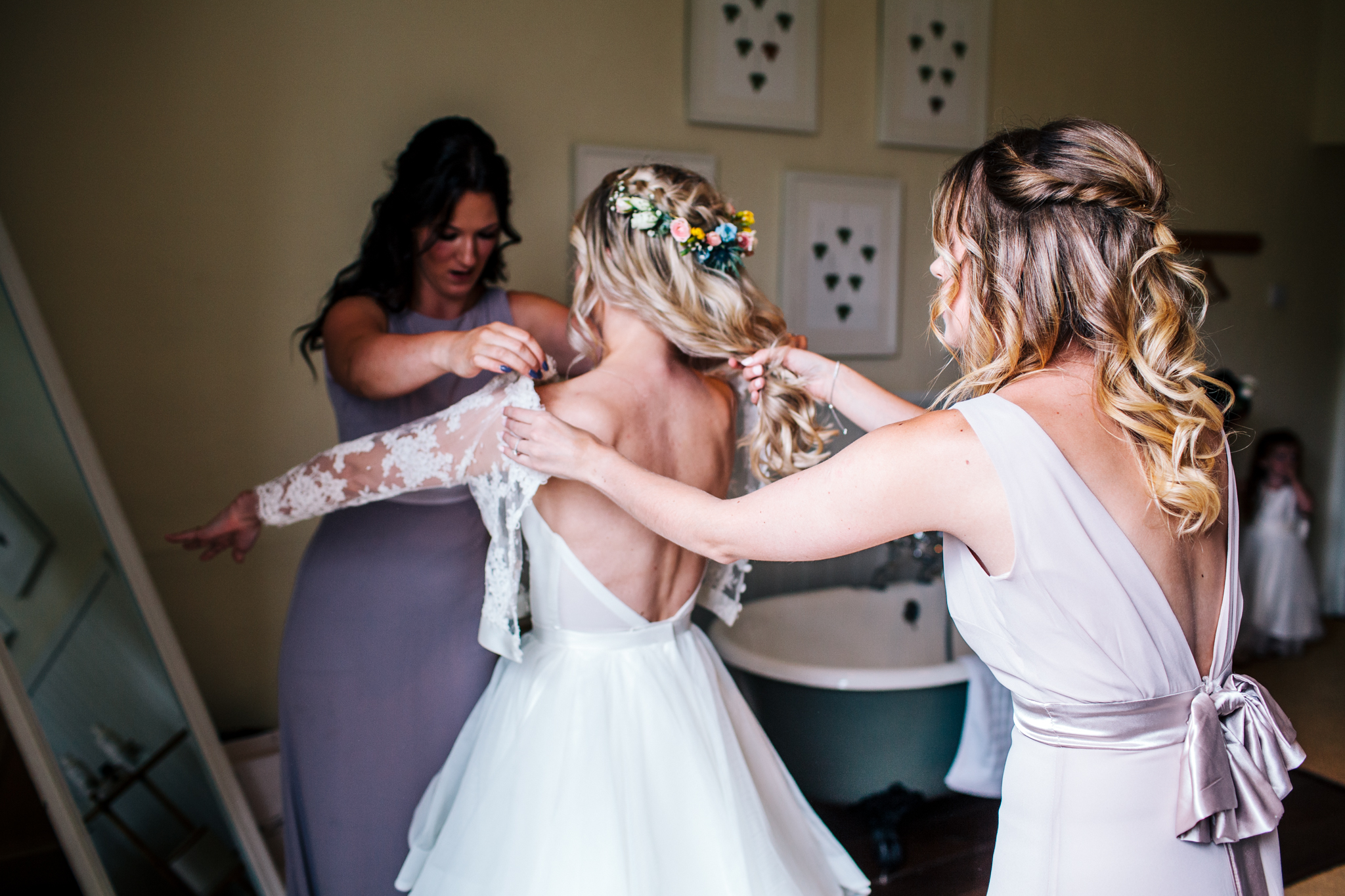 Bride wearing Emma Tindley separates of a lace top and layered skirt