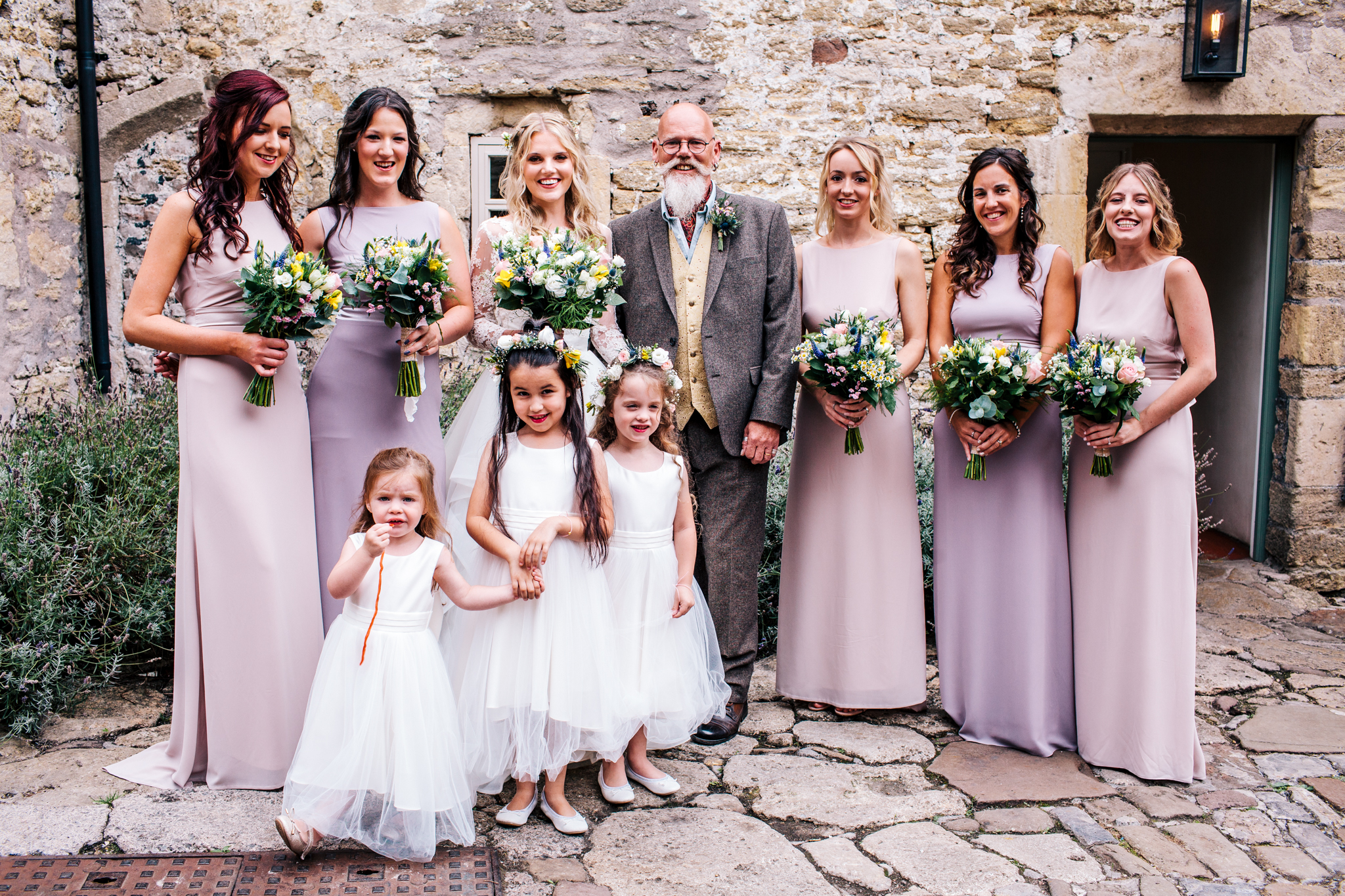 Group shot of bride and bridesmaid before the wedding at Mells Walled Garden