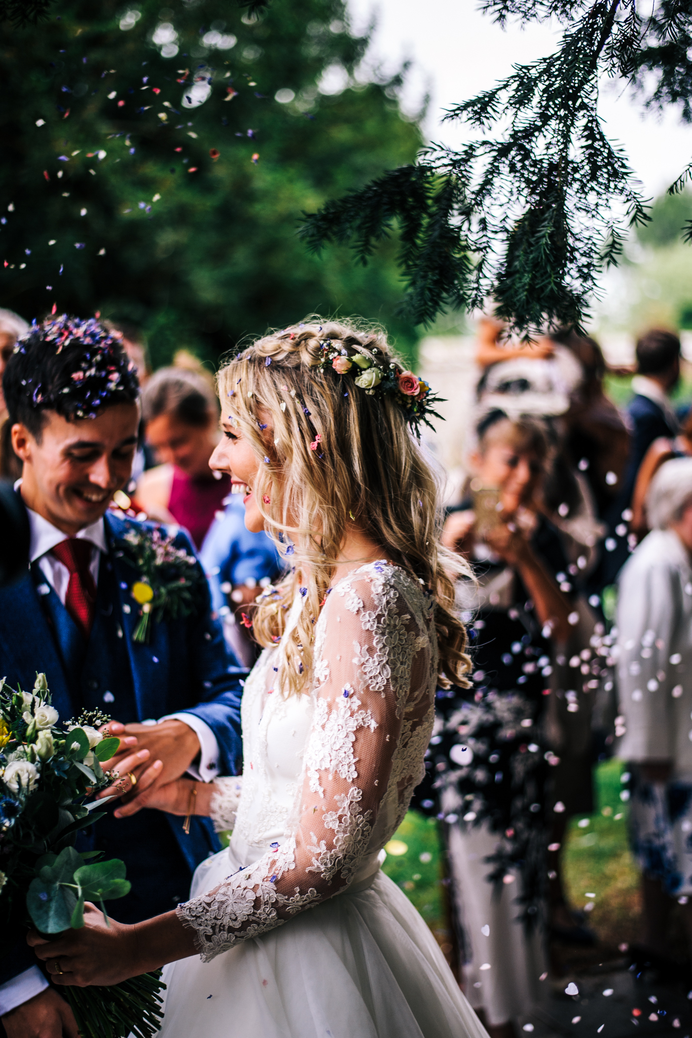 confetti falling down brides back outside St.Andrews Church at Mells Frome