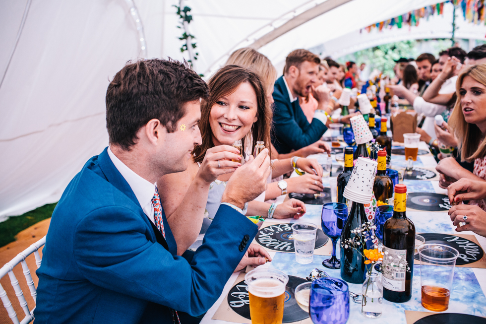 guests drinking home made shots at festival wedding